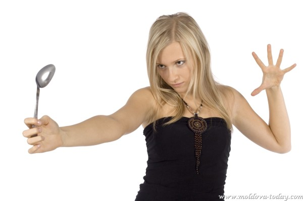 woman bending spoon by mind force