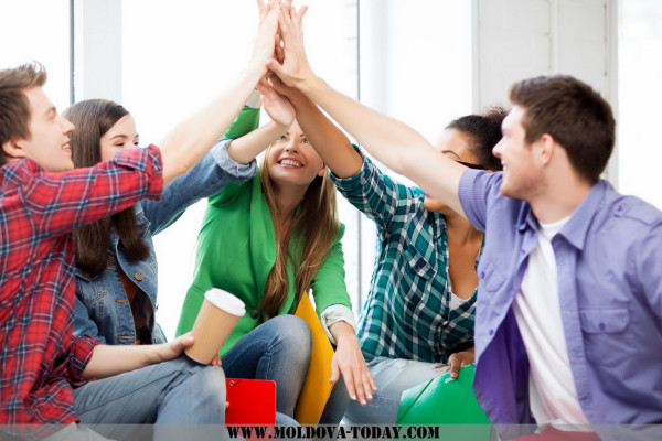 students giving high five at school