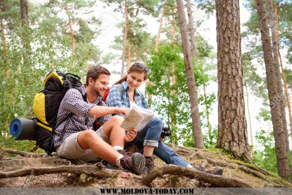31191714-Happy-couple-going-on-a-hike-together-in-a-forest-Stock-Photo