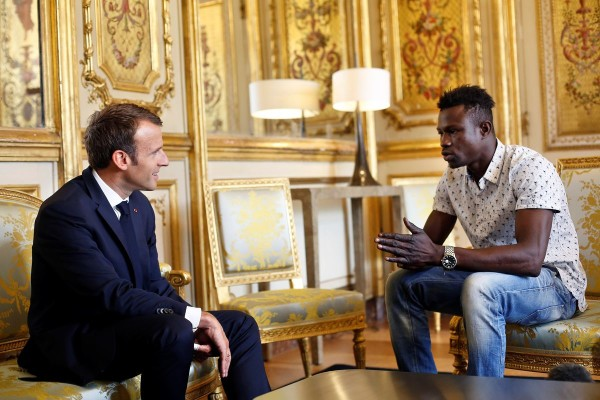 French President Emmanuel Macron meets with Mamoudou Gassama, 22, from Mali, at the Elysee Palace in Paris