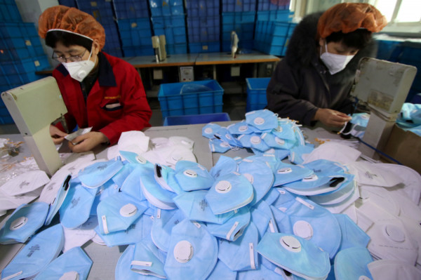Workers make protective masks at a factory in Handan, Hebei